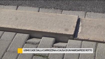 Uomo cade dalla carrozzina a causa di un marciapiede rotto – VIDEO